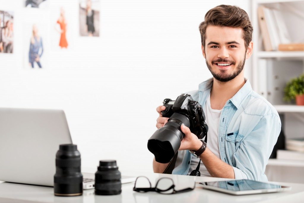 Young photographer smiling