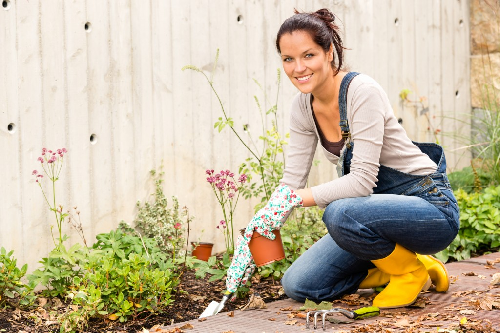 woman planting at her backyard