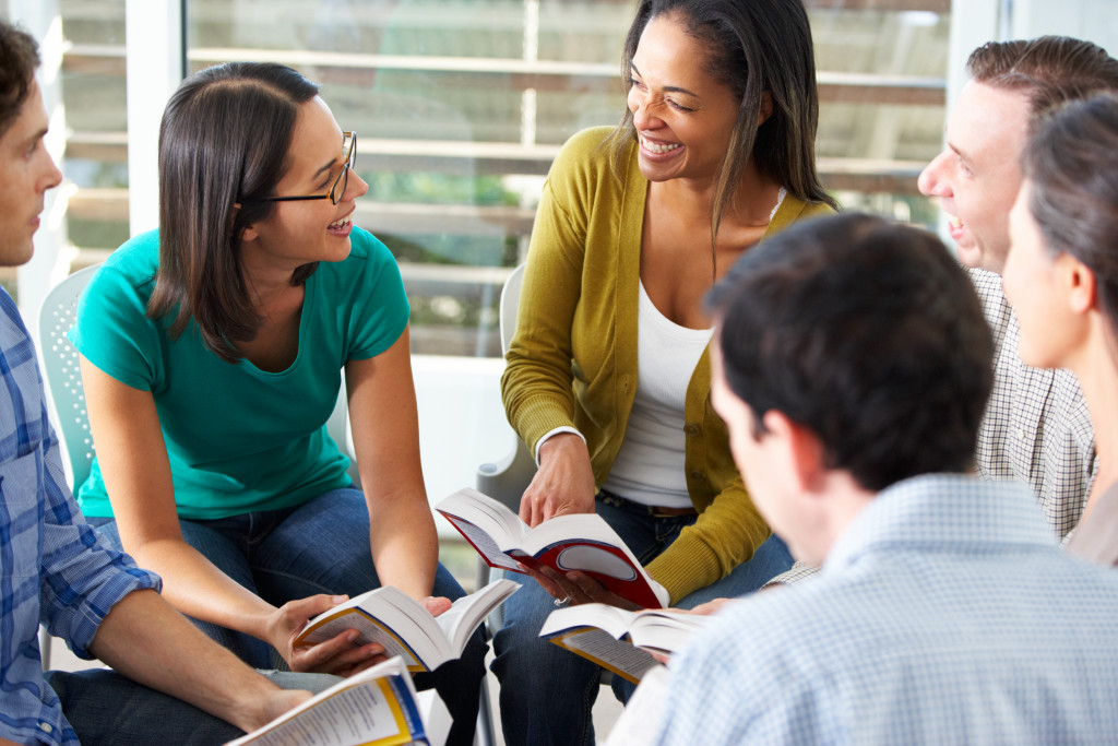 people discussing in the reading club