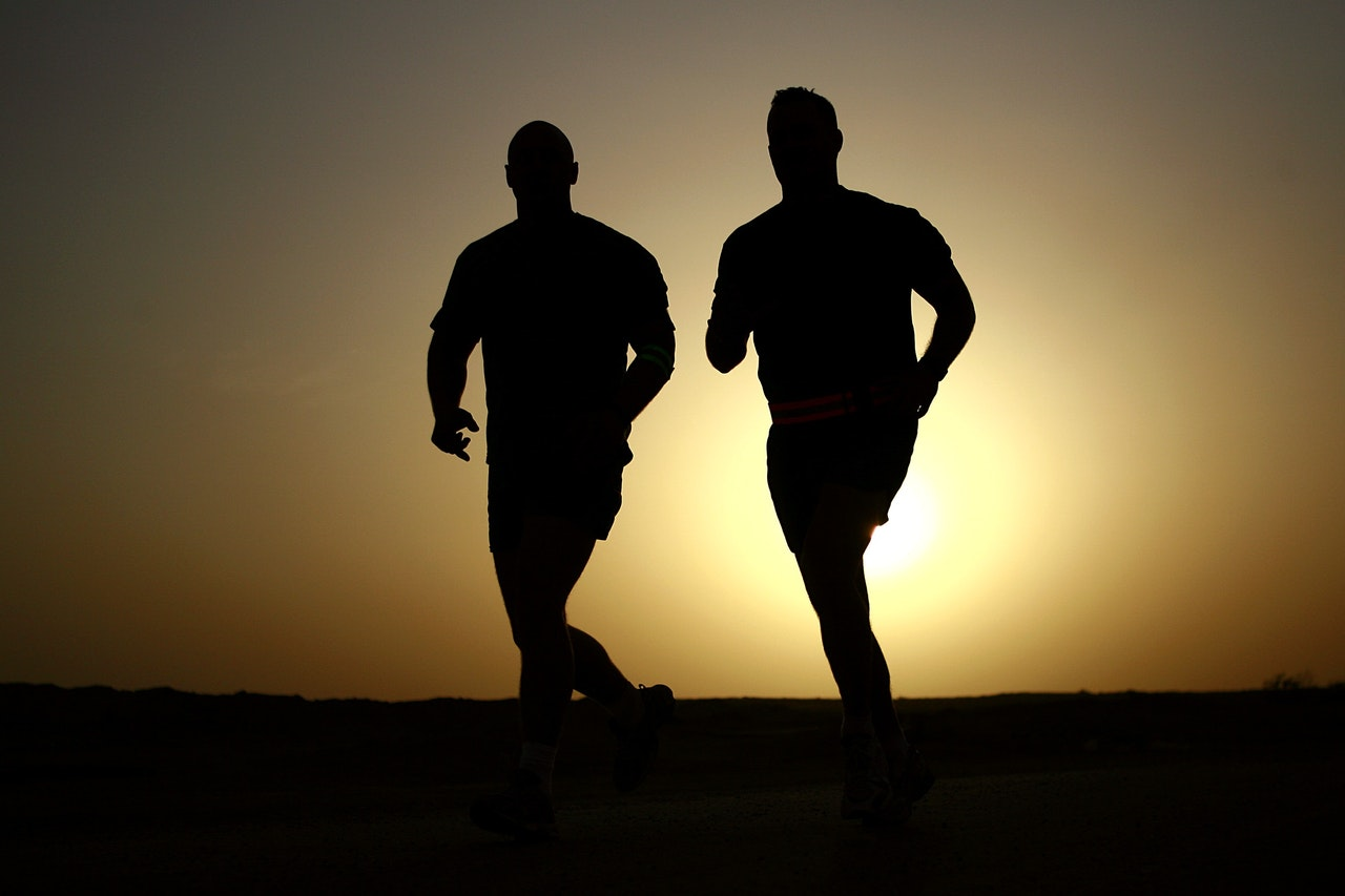 2 men jogging silhouette